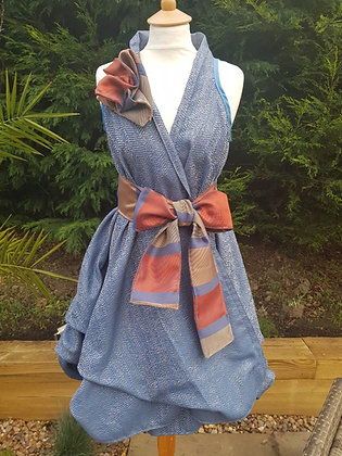 A one-off handmade wrap dress made from blue shimmer fabric