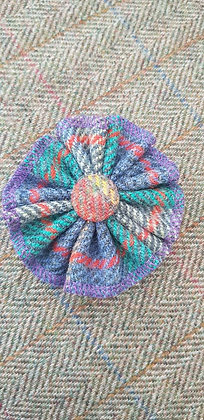 Handmade rosette flower tweed brooch made from Harris tweed wool.