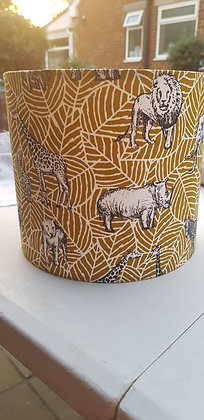 Handmade lampshade. Mustard leaf with black safari print animals.