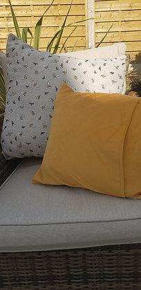 Handmade appliqued bee cushion with a mustard velvet back