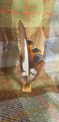 One-off feather brooch with natural feathers placed into a 9mm spent bullet