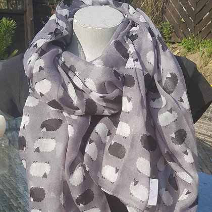Small black and white sheep on a grey lightweight fashion scarf.