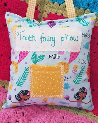 Handmade mermaids tooth fairy pillow with a mini front pocket.