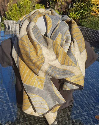 A supersoft mustard grey and lead grey leaf print scarf.  Reversible