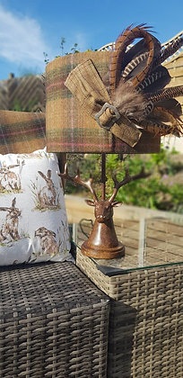 Handmade tweed lampshade finished off with tweed and feather trim