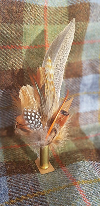 One-off feather brooch with natural and orange feathers
