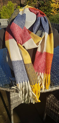 A brightly coloured supersoft tasselledscarf