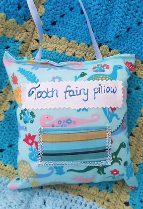 Handmade dinosaur tooth fairy pillow with a mini front pocket