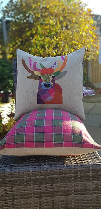 A one-off appliquéd stag on a 100% wool tweed speckledcushion