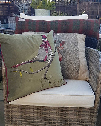 Appliqued pheasant on a moss green velvetcushion with polyester inner