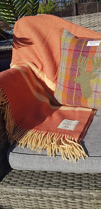 Apricot and paprika 100% pure newwool blanket. Substantial and a good weight