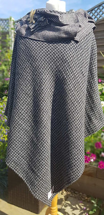 One-off handmade poncho made from grey and black dogtooth Harris Tweed cloth.