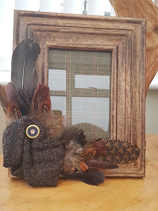 One-off hand-finished wooden frame tweed, feathers and cartridge.