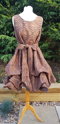 One-off handmade Alice dress made from rust and brown oval pattern fabric