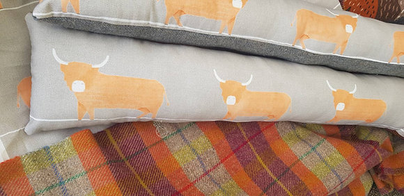 Handmade highland cowdraught excluder with a Harri stweed wool back