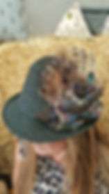 Handfinished tweed hats with feathers and tweed