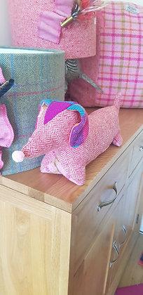 Stuffed plush dachshund. Beautiful pink tweed