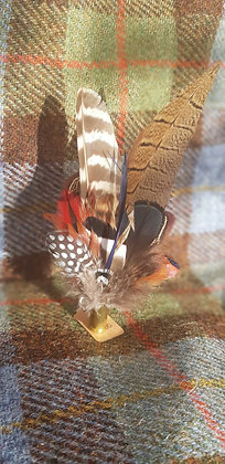 One-off feather brooch with natural with a slither of red and black feathers