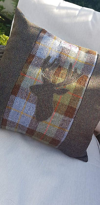 Handmade cushion made from HarrisTweed Mcleod wool with an appliquéd stag