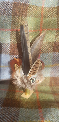 One-off feather brooch with black and natural feathers