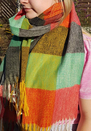 A brightly coloured supersoft tassledscarf