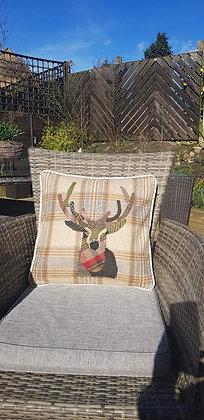 A one-off appliquéd stag on a 100% wool checkcushion - George