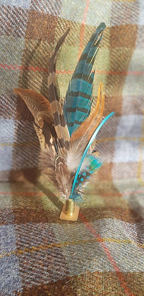 One-off feather brooch withnatural and jade greenfeathers