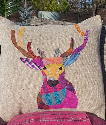 A one-off appliquéd stag on a 100% wool tweed speckled cushion