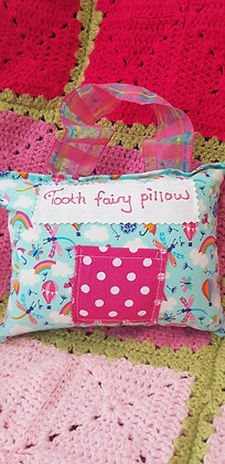Handmade rainbow tooth fairy pillow with a mini front pocket