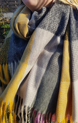 A supersoft tasselledscarf. Mustards, greys and charcoalslarge checks