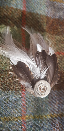 One-off feather brooch with natural and grey feathers