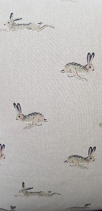 Handmade jumping hare cushion. Made from Sophie Allport fabri