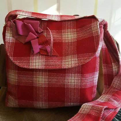 Handmade 100% wool hand bag. Fully lined with pocket and leather trim