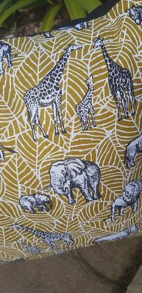 Mustard leaf print with black safari animals cushion