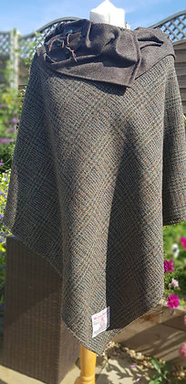 Hand-made, one-off winter poncho made using Harris Tweed wool.