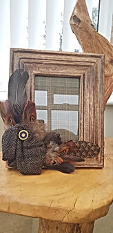 One-off wood frames, handfinsihed with tweed and feathers