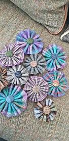Handmade tweed flower brooches in a range of styles