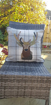 A one-off appliquéd stag cushion on a 100% wool tweed cushion with piped edging