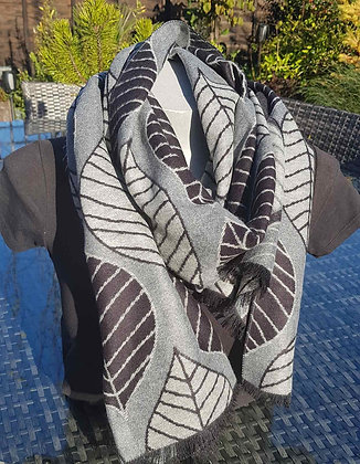 A supersoft grey, charcoal and black leaf print scarf