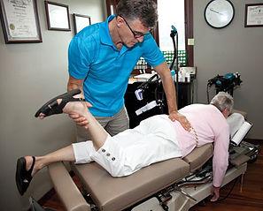 Dr. Goad adjusts a patient