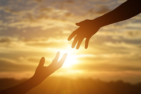 Silhouette of reaching, giving a helping