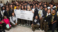 students holding check.jpg