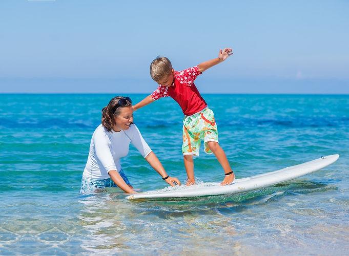 Surfer boy and mom