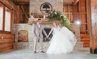 Couple In Front Of Stone Fireplace at Re