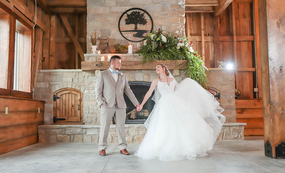Couple In Front Of Stone Fireplace at Red Oak Valley - Owensville, MO