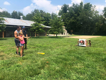 Young girl learning Archery at AAA Summe