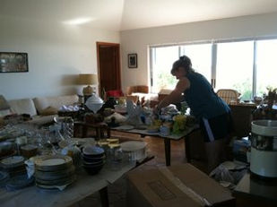 Paxem employee sorting household items