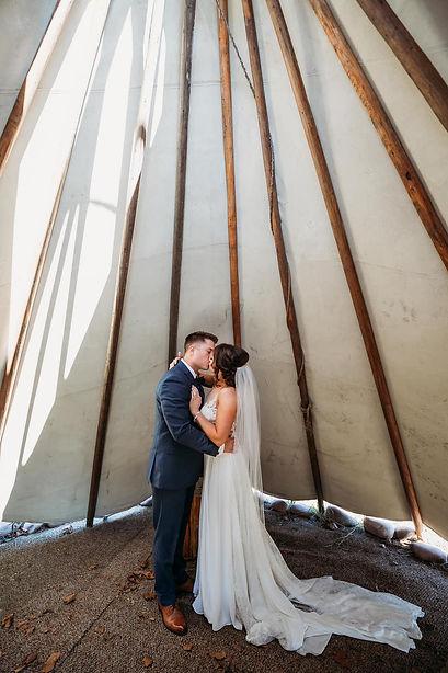 Boho wedding under tipi at Wicked Pony Ranch in Dittmer, MO