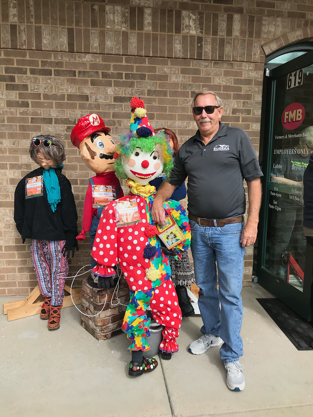 Clowning around with scarecrow friends - Eureka Contracting & Roofing - Eureka, MO
