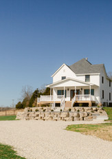 Exterior view of the Farmhouse at Red Oak Valley